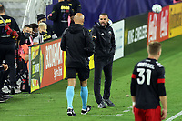 NASHVILLE, TN - SEPTEMBER 23: Head coach Ben Olsen of DC United argues with fourth official Robert Sibiga during a game between D.C. United and Nashville SC at Nissan Stadium on September 23, 2020 in Nashville, Tennessee.