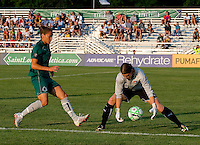 Saint Louis Athletica defender Nikki Cross (19) and Sky Blue FC goalkeeper Jenni Branam (23) during a WPS match at Anheuser Busch Soccer Park, in St. Louis, MO, July 22 2009. Athletica won the match 1-0.