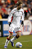 New England Revolution midfielder Steve Ralston (14) dribbles the ball.  The Chicago Fire defeated the New England Revolution 1-0 at Toyota Park in Bridgeview, IL on April 7, 2007.