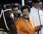 April 25, 2015 Churchill Downs Opening Night. The owner leads her winning colt into the Winner's Circle.  Cinco Charlie (Ricardo Santana Jr.) wins the first running of the $100,000 William Walker Stakes.  Owner L. William and Corinne Heiligbrodt, trainer Steven M. Asmussen. By Indian Charlie x Ten Halos (Marquetry)  ©Mary M. Meek/ESW/CSM