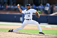 Asheville Tourists pitcher Rico Garcia (15) delivers a pitch during a game against the Rome Braves at McCormick Field on July 30, 2017 in Asheville, North Carolina. The Braves defeated the Tourists 7-3. (Tony Farlow/Four Seam Images)