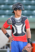 Catcher Jorge Alfaro (11) of the Hickory Crawdads prior to a game against the Greenville Drive on April 9, 2012, at Fluor Field at the West End in Greenville, South Carolina. Alfaro is the Texas Rangers' No. 7 prospect, according to Baseball America. (Tom Priddy/Four Seam Images)