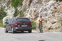 Radost standing by the road side in bad mood. Trebinje region. Republika Srpska. Bosnia Herzegovina, Europe.