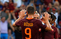 Calcio, Serie A: Roma vs Udinese. Roma, stadio Olimpico, 20 agosto 2016.<br /> Roma's Edin Dzeko, left, celebrates with teammates Radja Nainggolan, center, and Mohamed Salah, after scoring during the Italian Serie A football match between Roma and Udinese at Rome's Olympic Stadium, 20 August 2016. Roma won 4-0.<br /> UPDATE IMAGES PRESS/Riccardo De Luca