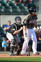 San Antonio Missions catcher Austin Hedges (15) tags Alex Yarbrough (7) to complete the strikeout during a game against the Arkansas Travelers on May 25, 2014 at Dickey-Stephens Park in Little Rock, Arkansas.  Arkansas defeated San Antonio 3-1.  (Mike Janes/Four Seam Images)