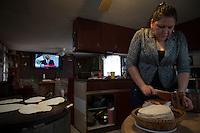 Esperanza Moctezuma prepares dinner for her family in Painesville, Ohio. March 25, 2014. Photo by Brendan Bannon.