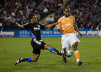 Quincy Amarikwa (left) slides tackles Julius James (3). San Jose Earthquakes defeated Houston Dynamo 3-2 at Buck Shaw Stadium in Santa Clara, California on March 28th, 2009.