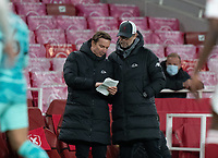 April 3rd 2021; Emriates Stadium, London, England;  Liverpools manager Jurgen Klopp consults assistant manager Pepijn Lijnders during the Premier League match between Arsenal and Liverpool at the Emirates Stadium in London