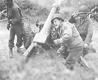 American howitzers shell German forces retreating near Carentan, France.  July 11, 1944.  Franklin.  (Army)<br /> NARA FILE #:  111-SC-191933<br /> WAR & CONFLICT BOOK #:  1047