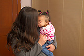 MR / Schenectady, NY. Infant (girl, 12 months, African American & Caucasian) and her mother (21) cuddle with each other. MR: Dal6, Dal4. ID: AL-HD. © Ellen B. Senisi