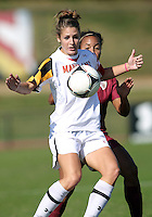 COLLEGE PARK, MD - OCTOBER 21, 2012:  Becky Kaplan (19) of the University of Maryland shields the ball from Ines Jaurena (2) of Florida State during an ACC women's match at Ludwig Field in College Park, MD. on October 21. Florida won 1-0.