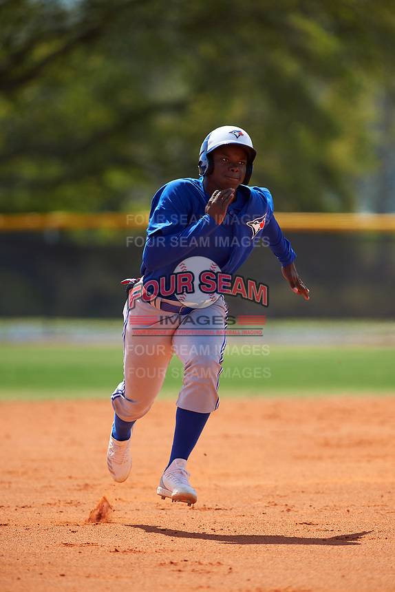 Toronto Blue Jays Peniel Brito (60) running the bases during an exhibition game against the Canada Junior National Team on March 8, 2020 at Baseball City in St. Petersburg, Florida.  (Mike Janes/Four Seam Images)