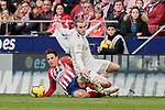 Atletico de Madrid's Santiago Arias and Real Madrid's Gareth Bale fight for the ball during La Liga match between Atletico de Madrid and Real Madrid at Wanda Metropolitano Stadium in Madrid, Spain. February 09, 2019. (ALTERPHOTOS/A. Perez Meca)