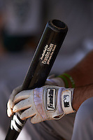 Oakland Athletics player holding a Brandon Moss bat in the dugout while wearing Franklin batting gloves during an instructional league game against the San Francisco Giants on October 12, 2015 at the Giants Baseball Complex in Scottsdale, Arizona.  (Mike Janes/Four Seam Images)
