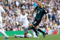LEEDS, ENGLAND - AUGUST 31: Mike van der Hoorn of Swansea City (R) is fouled by Kalvin Phillips of Leeds United during the Sky Bet Championship match between Leeds United and Swansea City at Elland Road on August 31, 2019 in Leeds, England. (Photo by Athena Pictures/Getty Images)