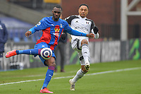 Christian Benteke of Crystal Palace and Kenny Tete of Fulham during the Premier League behind closed doors match between Crystal Palace and Fulham at Selhurst Park, London, England on 28 February 2021. Photo by Vince Mignott / PRiME Media Images.