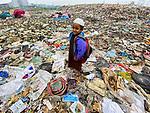 boys play atop mountain of rubbish<br /> <br /> Please byline: Sohel Parvez Haque/Solent News<br /> <br /> © Sohel Parvez Haque/Solent News & Photo Agency<br /> UK +44 (0) 2380 458800