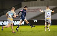 27th December 2020; AJ Bell Stadium, Salford, Lancashire, England; English Premiership Rugby, Sale Sharks versus Wasps;  AJ MacGinty of Sale Sharks kicks the ball through the Wasps defensive line