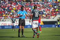 Orlando, Florida - Saturday, June 04, 2016: Patricio Loustau speaks to Paraguayan midfielder Derlis Gonzalez (10) during a Group A Copa America Centenario match between Costa Rica and Paraguay at Camping World Stadium.
