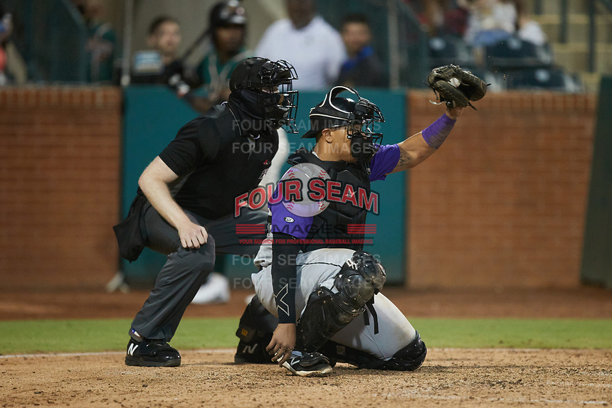 Winston-Salem Dash catcher Xavier Fernandez (12) frames a pitch as home plate umpire Mitch Leikam looks on during the game against the Greensboro Grasshoppers at First National Bank Field on June 3, 2021 in Greensboro, North Carolina. (Brian Westerholt/Four Seam Images)