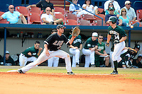 Long Island Blackbirds first baseman Tito Marrero #7 takes a throw as Trent Goodrich #14 runs through the bag during a game against the Dartmouth Big Green at Chain of Lakes Stadium on March 17, 2013 in Winter Haven, Florida.  Dartmouth defeated Long Island 11-4.  (Mike Janes/Four Seam Images)