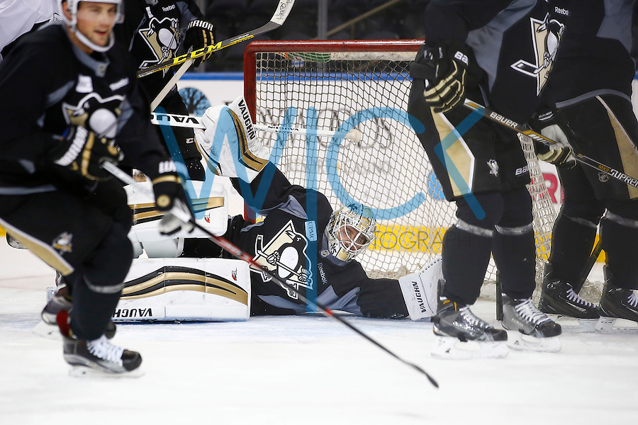 Matt Murray #30 of the Pittsburgh Penguins makes a save during practice at Madison Square Garden in New York City on April 20, 2016. (Photo by Jared Wickerham / DKPS)