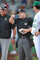 Home plate umpire Cameron Westover goes over the rules with both managers prior to the game  between the South Bend Silver Hawks and the Clinton LumberKings at Ashford University Field on July 26, 2014 in Clinton, Iowa. The Sliver Hawks won 2-0.   (Dennis Hubbard/Four Seam Images)