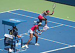 Serena and Venus Williams (in white visor) (USA) play in a doubles match against Ekaterina Makerova and Elena Vesnina (RUS) at the US Open being played at USTA Billie Jean King National Tennis Center in Flushing, NY on September 2, 2014