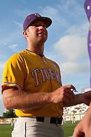 LSU Tigers catcher Jordy Snikeris #20 signs autographs before the NCAA Super Regional baseball game against Stony Brook on June 10, 2012 at Alex Box Stadium in Baton Rouge, Louisiana. Stony Brook defeated LSU 7-2 to advance to the College World Series. (Andrew Woolley/Four Seam Images)