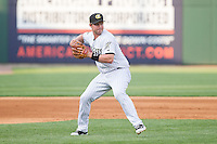Charlotte Knights third baseman Matt Davidson (22) makes a throw to first base against the Norfolk Tides at BB&T Ballpark on May 21, 2014 in Charlotte, North Carolina.  The Tides defeated the Knights 10-3.  (Brian Westerholt/Four Seam Images)