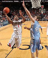 Jan. 8, 2011; Charlottesville, VA, USA; Virginia Cavaliers guard Jontel Evans (1) shoots the ball next to North Carolina Tar Heels forward Tyler Zeller (44) during the game at the John Paul Jones Arena. North Carolina won 62-56. Mandatory Credit: Andrew Shurtleff