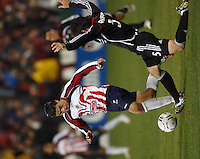 D. C. United defender (5) Facundo Erpen tackles the ball away from CD Guadalajara midfielder (7) Gonzalo Pineda during the first game of the CONCACAF Champions' Cup  Semifinal Series between CD Guadalajara of Mexico and D. C. United of the USA at Robert F. Kennedy Memorial Stadium, Washington, D. C., on March 15, 2007. DC United and CD Guadalajara played to a 1-1 tie.