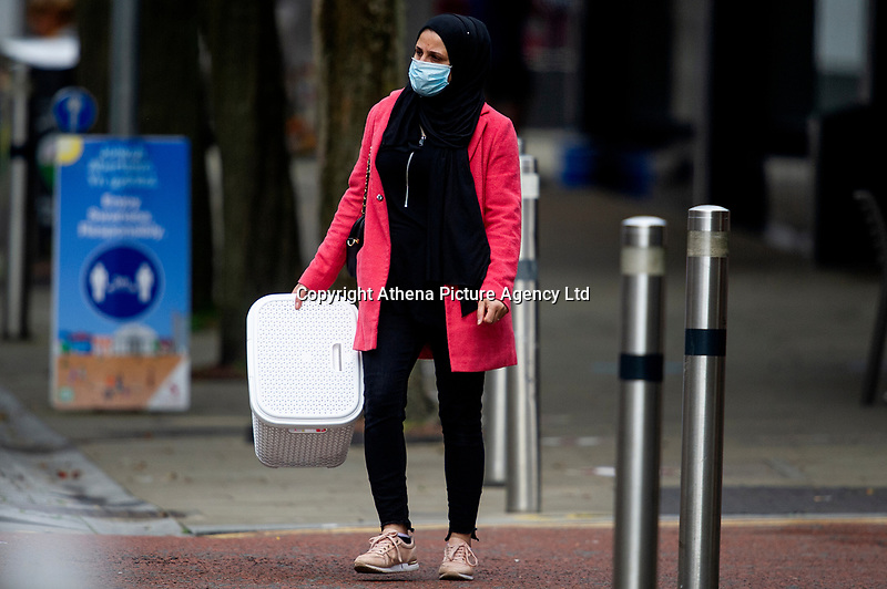 Pictured: A lady walks down St Mary's Square, Swansea city centre, Wales, UK. Monday 28 September 2020<br /> Re: Local lockdown will be in force from 6pm on the 27th September 2020 due to the Covid-19 Coronavirus pandemic, in Swansea, Wales, UK.