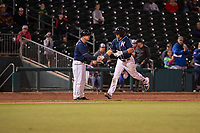 Northwest Arkansas Naturals infielder Angelo Castellano (16) (right) is congratulated by manager Darryl Kennedy (8) after hitting a home run on May 18, 2019, at Arvest Ballpark in Springdale, Arkansas. (Jason Ivester/Four Seam Images)