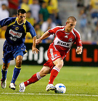 Chicago Fire forward Chad Barrett (9) dribbles past a Club America player.  Club America defeated the Chicago Fire 2-1 at Toyota Park in Bridgeview, IL on July 12, 2006.