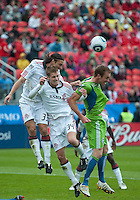 25 April 2010: Toronto FC defender Maksim Usanov #33 and Toronto FC defender Raivis Hscanovics #34 seem to have Seattle Sounders defender Tyson Wahl #5 in their grips during a game between the Seattle Sounders and Toronto FC at BMO Field in Toronto..Toronto FC won 2-0....