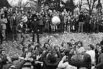 SHROVE TUESDAY AND ASH WEDNESDAY<br /> Royal Shrovetide Football<br /> ASHBOURNE, DERBYSHIRE 1974<br /> <br /> Although Shrovetide football, a sort of rugby with a minimum of rules, has died out in many places in Britain,   The game is played on both days between the Up'ards, those born north of the Henmore, a stream which runs through the town, and those that were born on the south side, the Down'ards. The pitch is a no-man's land between two watermills at either end<br /> of the town, about two miles apart. The Up'ards' goal is the<br /> Struston Mill, and the Down'ards' the Clifton Mill, a goal being scored when the ball touches the spot where the watermill wheel used to be three times. A round ball is used, made of shoe leather cut into panels sewn together with wax thread, and stuffed with cork dust. The balls are made and painted in the town, the organizing committee ordering about three or four each year. The tradition has grown up that the design which is painted on the ball<br /> should be the crest of the man who throws the ball up, or some reference to his profession. The game starts at 2 p.m. after a traditional lunch at the Green Man Hotel. The ball is carried through the streets to Shawcroft, a field near the centre of the town, and after a few words of encouragement and a warning about causing damage, the assembled crowds sing' Auld Lang Syne' and the National Anthem. The ball is then thrown up to start the game. Much of the game is centred around the Henmore, and is played in a series of rugby-type scrummages known as 'Hugs'. Occasion-<br /> ally the ball breaks free. The almost total absence of rules does not exclude one important exception -- the use of cars to carry the ball is not allowed. Should a goal be scored before 5 p.m. a new ball is thrown up again from Shawcroft. In 1890 and again in 1967 records were made with three goals in one day's play. Although play continues now only until 10 p.m., up until the 1920s play carried on until midnight