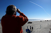 Photo by Rick Wilson--1/16/03--Spectators watch from Sunsplash (CQ) Park in Daytona Beach Thursday morning January 16, 2003 as the Space Shuttle Columbia rockets into space after lifting off from Kennedy Space Center at Cape Canaveral.