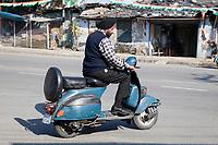 India, Dehradun.  A Sikh Man Riding a Motorbike--Wearing a Turban but no Helmet.