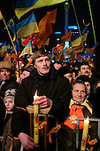 """Kiev, Ukraine.December 27, 2004..Perhaps the last """"Orange Revolution"""" rally in Kiev as election polls show him in a strong lead with 98% of the vote counted. ..Supporters of the opposition candidate Viktor Yushchenko rally to support him on Maidan Independence Square.  ..The first round of voting was considered fraudulent when the ruling president Viktor Yahukovich won and the opposition candidate Viktor Yushchenko lost. ..Several hundred thousand Ukrainians took to the streets of Kiev and held daily rallies on Maidan Independence Square. The protests lasted nearly a month before the first vote was declared invalid and a new round of elections held on December 26, 2004. ..The demonstrations would come to be known as the """"Orange Revolution"""" after the color of the opposition party."""