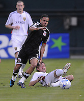 Real Salt Lake midfielder Carey Talley (3) slides to tackle the ball from DC United midfielder Fred (7). DC United defeated Real Salt Lake 4-1, at RFK Stadium in Washington DC, Saturday April 26, 2008.