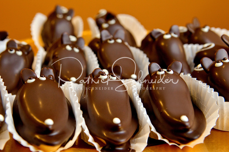 Small business photography of Concord NC's Chocolatier Barrucand shop at 1 Union Street in downtown Concord, North Carolina. Chocolate Mice with truffle ganache & almond frangipan filling are just one of the delicious items that can be found at the chocolatier. The small business is run by spouses Ann Marie and Jean Luc Barrucand. Photo is part of a photographic series of images featuring Concord, NC, by Charlotte-based photographer Patrick Schneider.