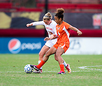 Jordan Roseboro (6) of Miami fights for the ball with Riley Barger (10) of Maryland during the game at Ludwig Field in College Park, MD.  Maryland defeated Miami, 2-1, in overtime.