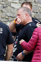 Pictured: Gareth Thomas' husband Stephen (C) tries to hold back tears. Sunday 15 September 2019<br /> Re: Ironman triathlon event in Tenby, Wales, UK.