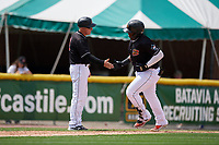 Batavia Muckdogs manager Tom Lawless (10) congratulates Albert Guaimaro (13) after hitting a home run during a NY-Penn League game against the Williamsport Crosscutters on August 27, 2019 at Dwyer Stadium in Batavia, New York.  Williamsport defeated Batavia 11-4.  (Mike Janes/Four Seam Images)