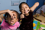 Education Preschool 3-4 year olds girls posing making silly faces clowning horizonal