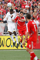 Los Angeles Galaxy midfielder Brandon McDonald (32) and Toronto FC forward Jarrod Smith (23). Toronto FC defeated the Los Angeles Galaxy 2-0 during a Major League Soccer match at BMO Field in Toronto, Ontario, Canada, on May 31, 2008.