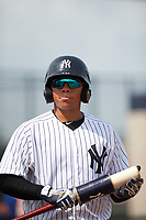 GCL Yankees East catcher Carlos Gallardo (16) on deck during the first game of a doubleheader against the GCL Blue Jays on July 24, 2017 at the Yankees Minor League Complex in Tampa, Florida.  GCL Blue Jays defeated the GCL Yankees East 6-3 in a game that originally started on July 8th.  (Mike Janes/Four Seam Images)