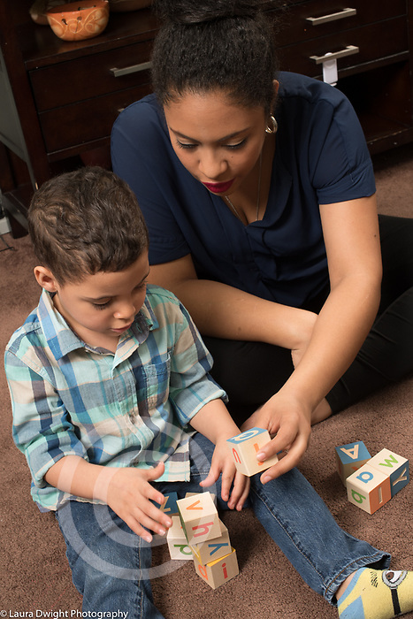 3 year old boy and mother playing with blocks, talking, learning the alphabet