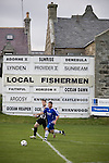 Fraserburgh 2 Strathspey Thistle 2, 06/11/2010. Bellslea Park, Highland League. Players framed by an advertisement showing the names of local fishing boats at Bellslea Park, during Fraserburgh's Highland League fixture against visitors Strathspey Thistle (in blue). Nicknamed 'The Broch,' Fraserburgh have been members of the Highland League since 1921 having been formed 11 years earlier. The match ended in a 2-2 draw in front of a crowd of 302. Photo by Colin McPherson.